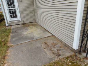 St Paul Waterproofing concrete patio settled causing a leaky basement