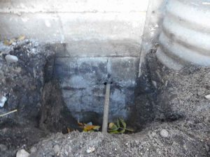 Minneapolis Basement Waterproofing Hole Found Around Electric Line By Well
