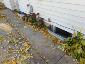 Minneapolis Basement Waterproofing Sidewalk Tilted Wrong Way Letting Water In