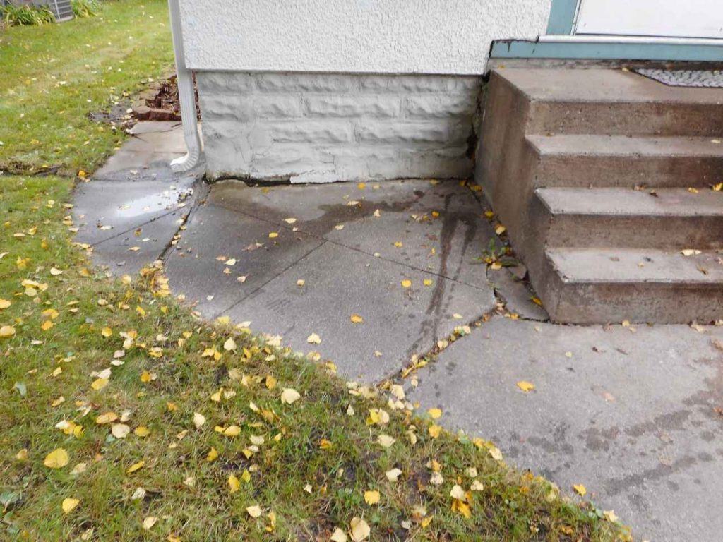 Problem area by concrete step and sidewalk