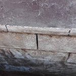 Visible gaps in the foundation wall