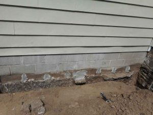 Repaired foundation cracks and holes.